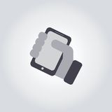 Mobile phone in hand icon Stock Images