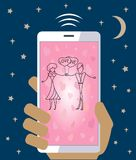 Mobile phone in hand sending love wedding Valentine. Hand holding a mobile phone and sending love messages Royalty Free Stock Photography