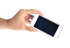 Mobile phone in hand on white background Royalty Free Stock Images