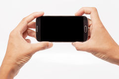 Mobile phone in hand on a white background. Mobile phone in male hand on a white background Stock Images
