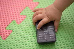 Mobile phone in hands of children. Mobile phone in the hands of children Stock Images