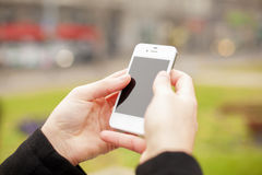 Mobile phone in hands Stock Photo