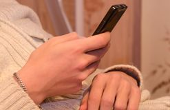 Close up of a man using mobile smart phone. A mobile phone in the hands. Playing on the phone Stock Images