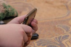 Close up of a man using mobile smart phone. A mobile phone in the hands. Playing on the phone stock photos