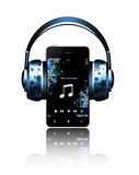 Mobile phone and headphones with christmas elements Royalty Free Stock Photography