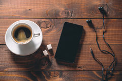 Mobile phone with headphones, a Cup of coffee Royalty Free Stock Photo