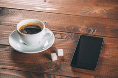 Mobile phone with headphones, a Cup of coffee Stock Photo