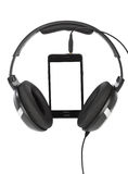 Mobile phone and headphones Stock Image