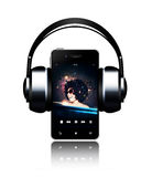 Mobile phone and headphones with music listening woman on touch Royalty Free Stock Photo