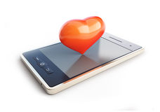 Mobile phone with a heart on the couch Stock Photos