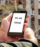 Mobile phone, We are hiring caption royalty free stock images