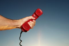 Mobile Phone hotline outdoors. Red phone in landscape. See my other works in portfolio stock photos