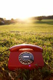Mobile Phone hotline outdoors. Red phone in landscape. See my other works in portfolio royalty free stock photo