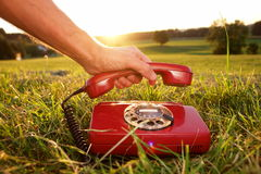 Mobile Phone hotline outdoors. Red phone in landscape. See my other works in portfolio stock images