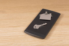 Mobile phone with house key and tag Stock Image