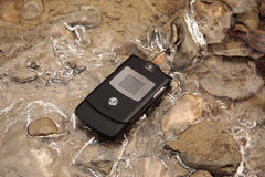 Mobile phone on ice. Hot technology in a cold environment royalty free stock images