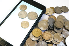 Mobile phone with Indian coins Royalty Free Stock Images