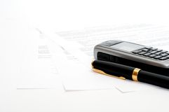 Mobile phone and ink pen Stock Photo