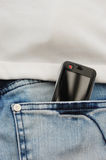 Mobile Phone in jeans. A non-branded cell phone/mobile in the back pocket of a pair of youth's jeans. Screen has been cleared for your own copy/message call me Stock Photography