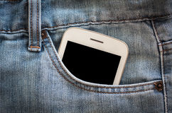 Mobile phone in jeans pocket Stock Photos