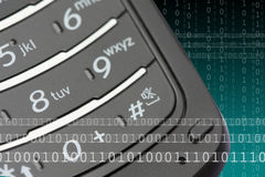 Mobile Phone Keypad. Closeup of mobile phone keypad with binary code graphics royalty free stock photos