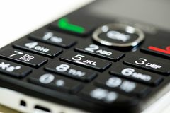 Mobile phone keypad close up macro shot, shallow depth of field. Image for background royalty free stock photos