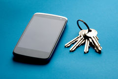 Mobile phone with a keys Royalty Free Stock Photos
