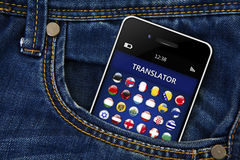 Mobile phone with language translator application in jeans pocket. Mobile phone with language translator application in jeans trousers pocket royalty free stock photos