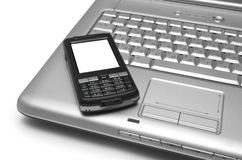 Mobile phone and laptop Stock Photo