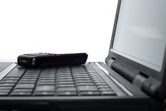 Mobile phone on a laptop Stock Photography