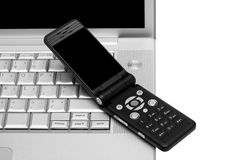 Mobile phone and laptop Stock Photography
