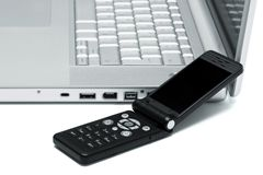 Mobile phone and laptop Royalty Free Stock Photography