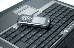 Mobile phone and laptop Stock Image