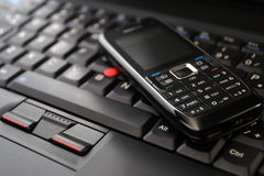 Mobile phone and laptop keyboard Stock Image