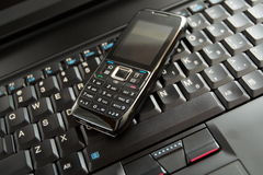 Mobile phone and laptop keyboard Royalty Free Stock Images