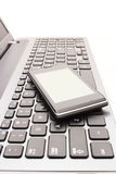 Mobile phone with laptop keyboard Royalty Free Stock Image