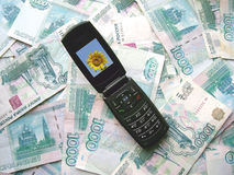 Mobile phone laying on banknotes of Russia Stock Photos