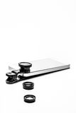 Mobile Phone laying with Clip on Photo Camera Lenses. A Mobile Phone laying flat with three Clip on Photo Lenses royalty free stock photo