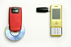 Mobile phone loads. Red and yellow mobile telephones Royalty Free Stock Photography