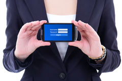 Mobile phone with login panel on screen in female hands Stock Photo