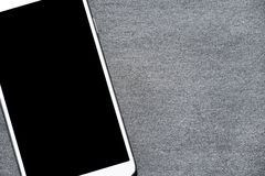 Mobile phone lying on the gray surface stock photos