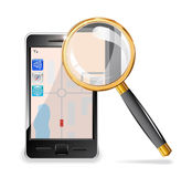 Mobile phone and a magnifying glass. Royalty Free Stock Image