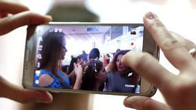 Mobile phone, making photos, shoots video in frame stylists, makeup artists, hairdressers, working with the model. Kherson, Ukraine - 15 June 2016: mobile phone stock video