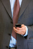Mobile phone in man hand. Close-up. Royalty Free Stock Photo