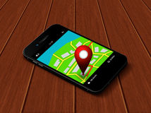 Mobile phone with map and gps application  lying on table Royalty Free Stock Images