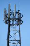 Mobile phone mast. Against blue sky royalty free stock photo