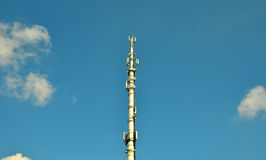 Mobile phone mast. A mobile phone mast against a blue sky royalty free stock photography