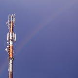 Mobile phone mast. With rainbow behind stock photos