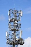 Mobile phone mast. Telecommunication aerial isolated against blue sky Stock Photos