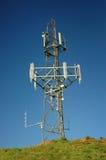 Mobile phone mast. A telecommunications mast. Polarizing used to enhance the sky royalty free stock image
